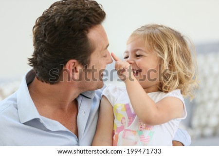 Daddy with little girl having fun together - stock photo