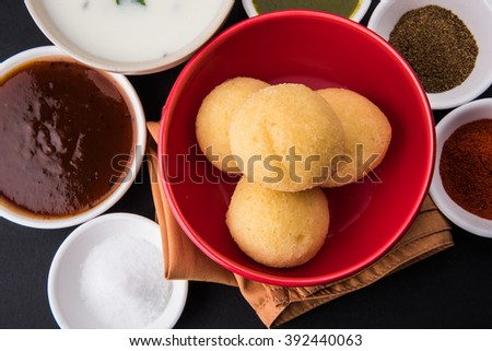 dahi vada or dahi vade also known as Curd Vadai in South India, a popular snack famous all over India prepared by soaking lentil vadas in thick dahi or yogurt, topped with spicy & sweet chutney etc - stock photo