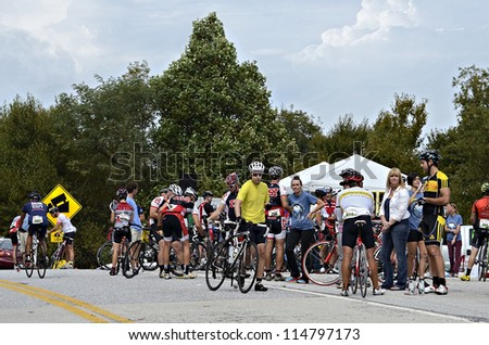 Dahlonega, GA/USA - SEPTEMBER 30: A crowd of people at a rest stop during the  Six Gap Century ride, September 30, 2012 in Dahlonega GA. - stock photo