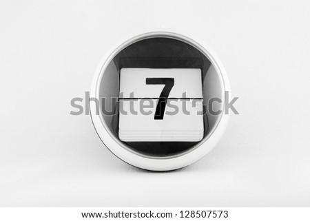 Daily calendar date change on a white background. day 7 - stock photo