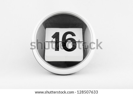 Daily calendar date change on a white background. day 16 - stock photo
