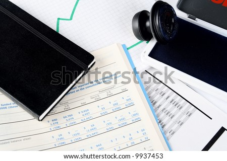 Daily financial reports, notepad and stamp - stock photo