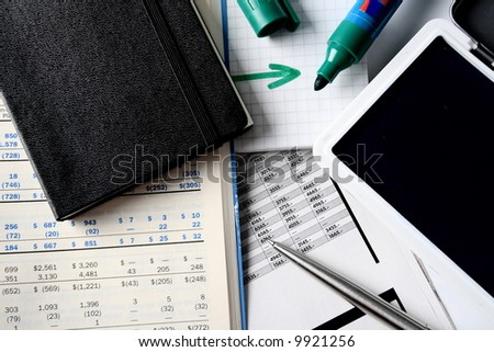 Daily financial reports, pen and notepad - stock photo