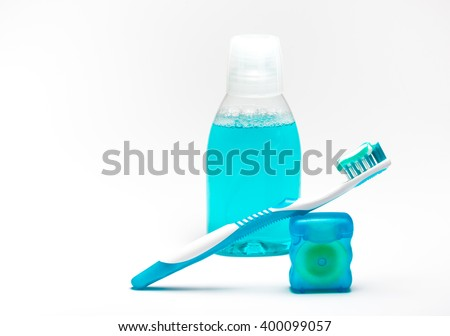Daily hygiene of the oral cavity - toothpaste, dental floss, tooth brush and rinse of mouth. Dental health - oral hygiene complete, isolated on white background. - stock photo