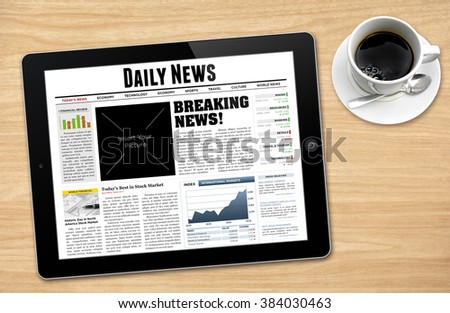 Daily News displayed on tablet with a cup of coffee. - stock photo