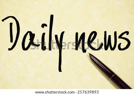 daily news text write on paper  - stock photo