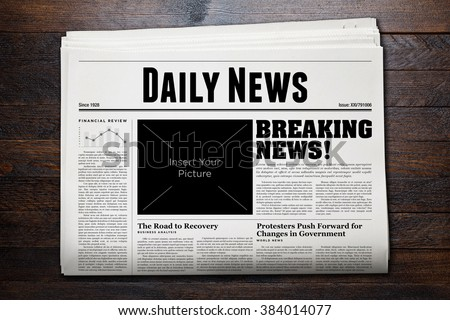 Daily Newspaper with wooden background. - stock photo