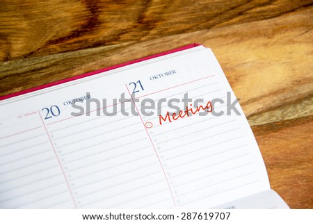 daily planner with meeting marked - stock photo
