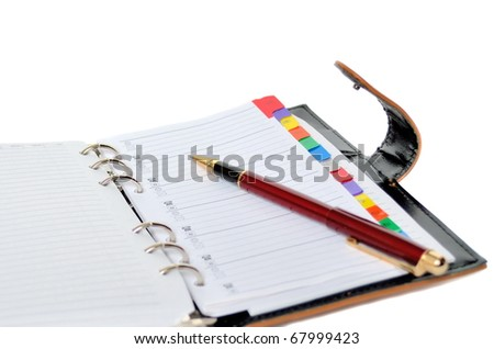 Daily planner with pen - stock photo