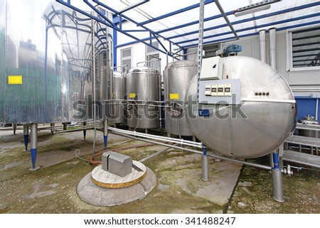Dairy Factory Tanks for Milk Chilling and Refrigeration - stock photo