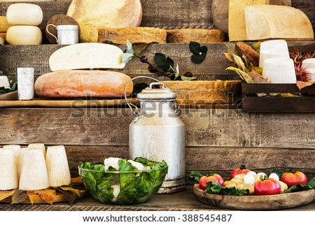 Dairy products and vegetables on the wooden background. Grocery shop. - stock photo