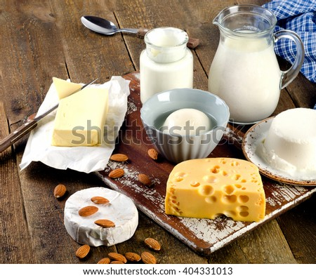 Dairy products on wooden background - stock photo