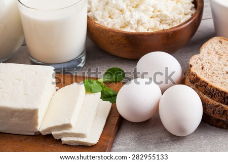 Dairy products on wooden table - stock photo