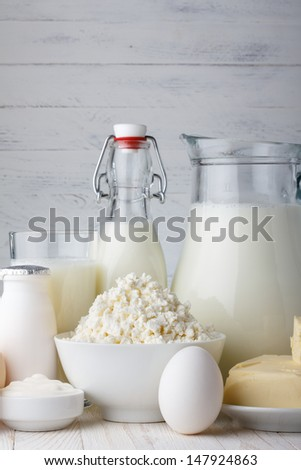Dairy products on wooden table close-up - stock photo