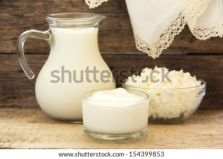 Dairy products: sour cream, milk, cottage cheese. - stock photo