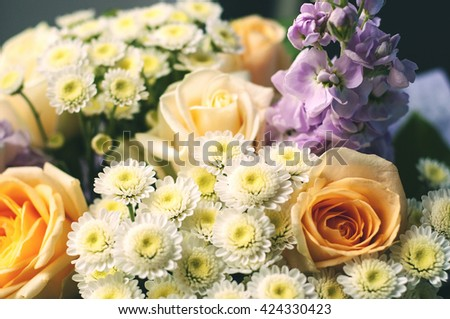 Daisy, chrysanthemum, rose and mix of summer flowers bouquet for happy or sorrow events - stock photo