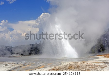 Daisy Geyser Erupting at an angle in Yellowstone National Park - stock photo