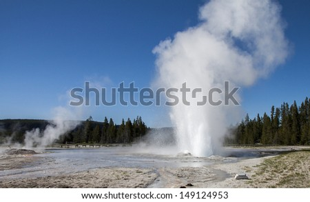 Daisy Geyser erupting in the Upper Geyser Basin of Yellowstone National Park, Wyoming - stock photo