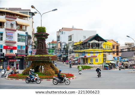 DALAT, VIETNAM - JULY 17, 2014: A view at a tiny Eiffel Tower (flower bed) not far from the downtown. Dalat has several nicknames - little Paris of Asia is one of them. - stock photo