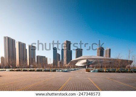 Dalian, China January 19, 2015: Dalian International Conference Center. The building is combines of Conference Center, Theater and Opera House and Exhibition Center. - stock photo