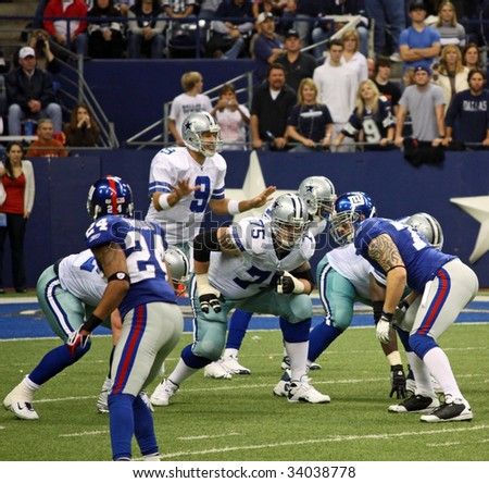 DALLAS – DEC 14: Dallas Cowboys Quarterback Tony Romo calls signals before the snap from center during a game between the Cowboys and Bengals at Texas Stadium, Irving December 14, 2008 in Dallas, TX. - stock photo