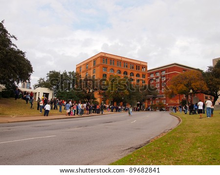 DALLAS - NOV 25: Tourists visit Dealey Plaza outside the Sixth Floor Museum, November 25, 2011, in Dallas, Texas. The museum is about the Kennedy Assassination and draws 325,000 visitors annually. - stock photo