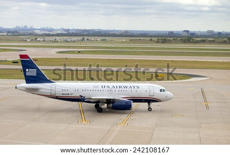 Dallas, Texas, USA - September 18, 2014: US Airways airline passenger jet on the tarmac in Dallas - Ft Worth Airport with Dallas, Texas in the background on September 18, 2014 - stock photo