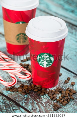 DALLAS, TX - NOVEMBER 18, 2014: A cup of Starbucks popular holiday beverage, peppermint mocha, displayed with coffee beans and candy canes on wooden table.  - stock photo