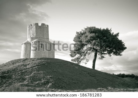 Dalmatian stone church on the hill, near town of Nin, Croatia - stock photo