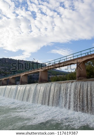 Dam for water in the river - stock photo