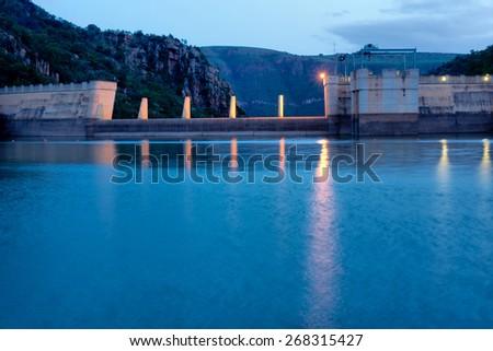 Dam wall in evening light. Shot on Paris Dam, South Africa.  - stock photo