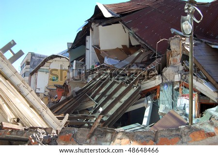 Damage done to houses by the 2010 earthquake with 8.8 magnitude in Concepcion city, Chile. - stock photo