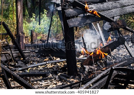 damage wood house from firer accident. - stock photo