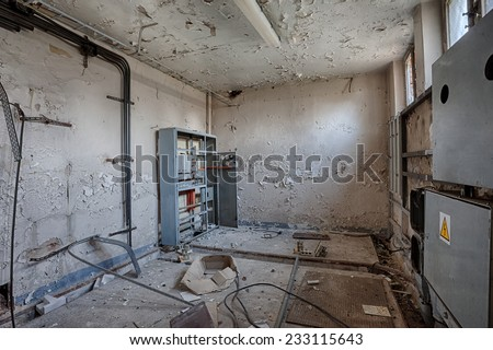 Damaged electrical switchboard room - stock photo
