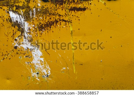 Damaged Metal Surface; damaged/worn yellow-painted industrial metal surface. Good copy space  - stock photo