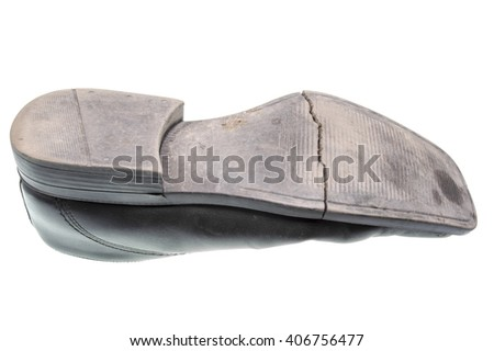 Damaged sole of a black shoe isolated - stock photo