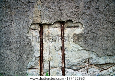Damaged surface of a concrete wall - stock photo