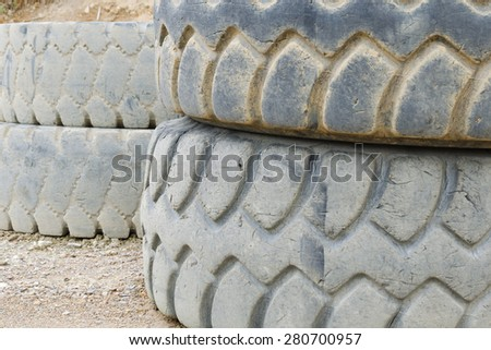 Damaged tires of heavy dump truck - stock photo