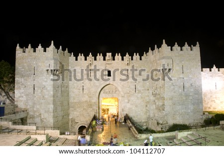 Damascus Gate entrance Old City Jerusalem Palestine Israel  night light long exposure motion blur faces - stock photo