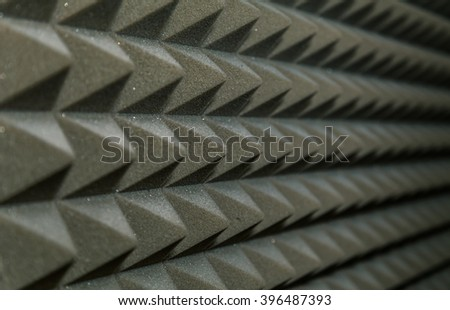 Dampening acoustical foam on recording studio wall - stock photo