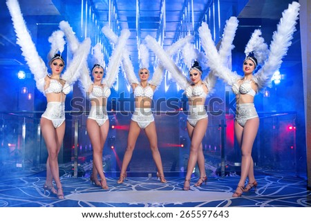 dance group of sexy young woman in costume, at the disco - stock photo