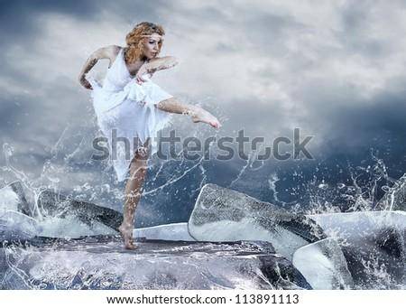 Dance of ballerina on the ice dancepool around splashes of water drops - stock photo
