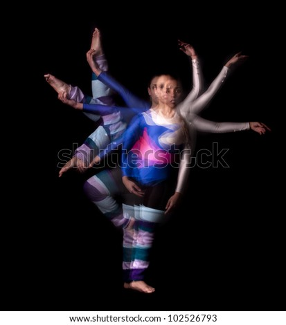 Dancer moving against a black background - stock photo