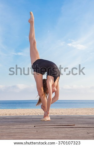 dancer or gymnast doing stretch exercise - stock photo