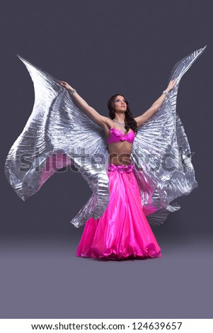 dancer performing oriental dance with wings - stock photo