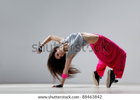 dancer posing on studio background - stock photo
