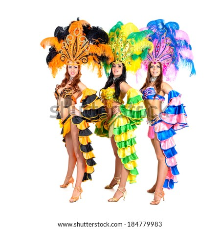 dancer team wearing carnival costumes dancing against isolated white background - stock photo