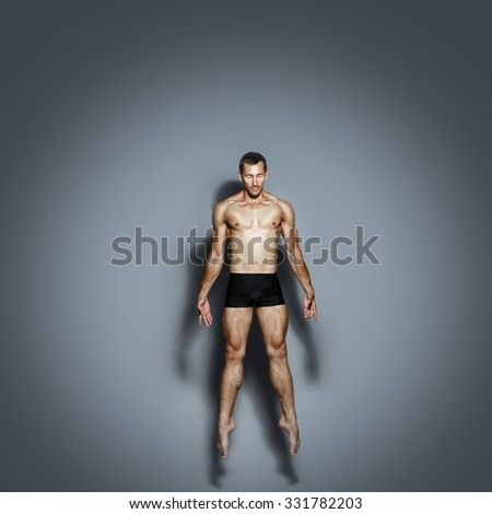 Dancer with a naked torso in a jump - stock photo