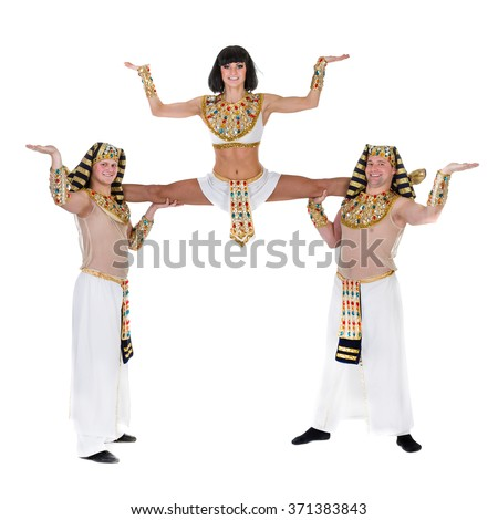 dancers dressed in Egyptian costumes posing - stock photo
