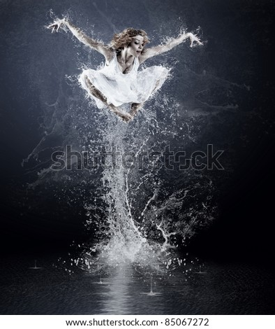 Dancers jump from water with splashes and drops - stock photo